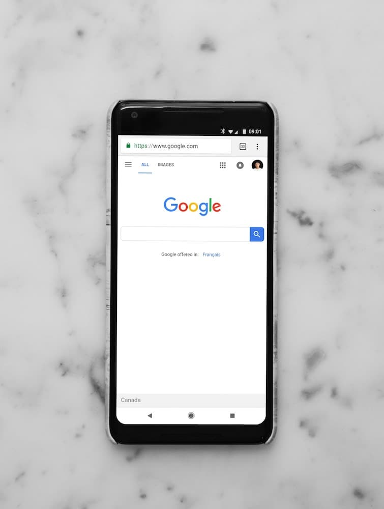 Image depicting a phone with a google search browser tab open